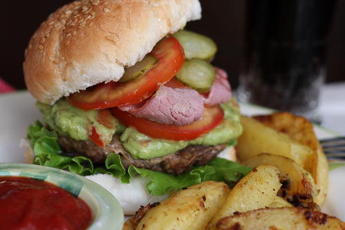 Homemade hamburgers with bacon and zesty guacamole