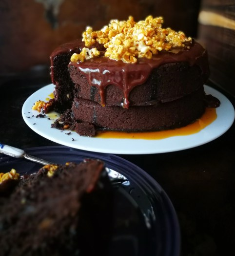 Peanut butter chocolate cake with a salted caramel and popcorn topping.