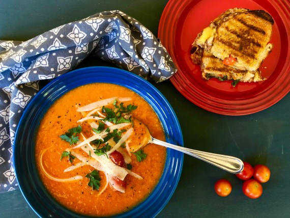 Easy roasted tomato soup with toasted cheese, sweet peppers, spinach and artichoke sandwich.