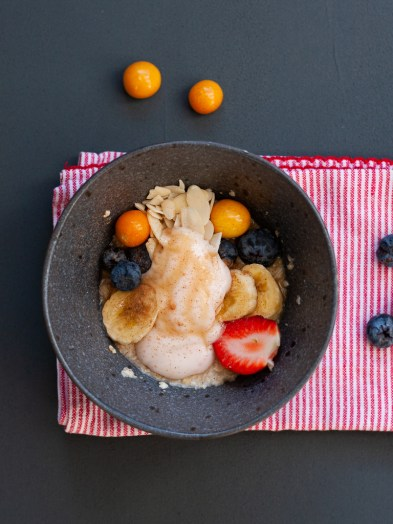 Berry and yogurt cinnamon oatmeal bowl.